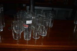 Twenty-Seven Assorted Branded Half Pint Glasses