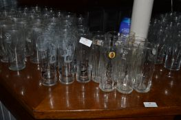 Nine Carling and Nine Fosters Half Pint Glasses
