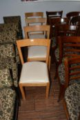 Four Beech Framed Dining Chairs with Cream Leather Seats