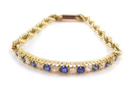 A Victorian sapphire and rose cut diamond set bracelet, claw mounted, with a later rope twist
