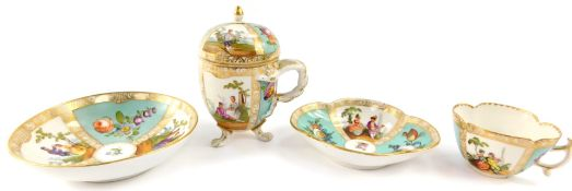 A Helena Wolfsohn late 19thC porcelain chocolate cup cover and saucer, decorated with courting