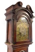 A Georgian oak cased longcase clock by Gamwel of Alford, the brass break arch dial with rococo
