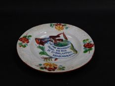 An early 19thC pearl ware commemorative tea plate, clobbered and transfer decorated in blue and