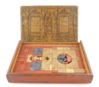 A Richters late 19thC Anchor box, containing building stones in three colours, boxed with printed