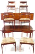 A McIntosh and Co Limited 1960's Rosewood dining suite, comprising a sideboard, with a pair of doors