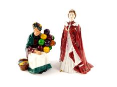 A Royal Doulton figure modelled as The Old Balloon Seller HN1315, together with a Royal Worcester