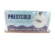A mid 20thC Prestcold Refrigeration glass advertising clock, of rectangular section, with a circular