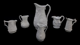 Six Portmeirion Heritage Collection parian relief moulded jugs, printed and raised marks, 9-, 22cm