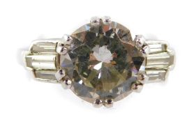 A diamond dress ring, with central brilliant cut round diamond 8.67mm x 4.70mm