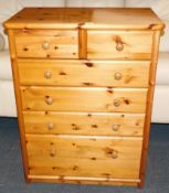 A pine chest, of two over four drawers, raised on a plinth base, 107cm high, 82cm wide, 49cm deep.