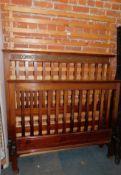 An Edwardian mahogany double bed frame, 144cm high.