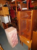 A Schreiber bedside chest, television stand, tables, magazine rack and an ottoman. (7)