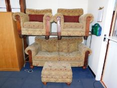 A Showframe two seater sofa, decorated in an elephant pattern fabric, with scatter cushions, 190cm