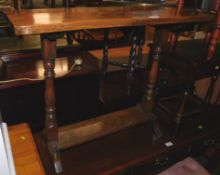 A 17thC style oak side table, raised on turned columns terminating on splayed legs, 86m high, 81cm