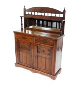 A Victorian mahogany chiffonier, the mirrored back with single shelf raised on turned supports, over