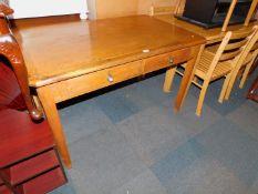 An oak and oak veneered Abbess style two drawer desk, 76cm high, 121cm wide, 76cm deep.