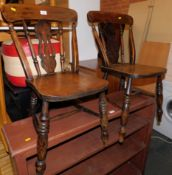 A pair of 19thC beech spindle back kitchen chairs.
