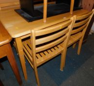 A beech kitchen table, 75cm high, 114cm wide, 70cm deep., and four ladder back chairs. (5)