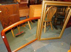 A gilt framed mirror, 76cm x 108cm., together with a mahogany overmantel mirror, 75cm x 100cm. (2)