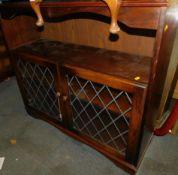 An oak Old Charm style glazed side cabinet, 100cm high, 111cm wide, 34cm deep.