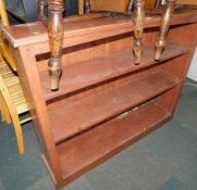 A stained pine bookcase, enclosing two fixed shelves, 97cm high, 122cm wide, 27cm deep.