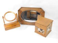 An oak framed mirror, 75cm wide, 52cm deep., together with a pine swing framed mirror, 53cm high,