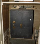 A late 19th/early 20thC safe, with brass handles and escutcheons, unmarked, 64cm high, 49cm wide.
