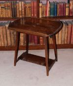 An early 20thC oak occasional table, the top with a raised gallery, on square tapering legs, with