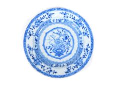 An 18thC Chinese blue and white plate, decorated with a stylized vase of flowers and cell border,