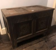 A 17thC two panel coffer, with wainscot top having slight reducing, demi-lune carved frieze over a