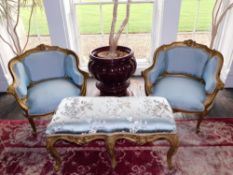 A pair of Louis XV style French gilt wood and gesso fauteuils, each with a moulded show frame,