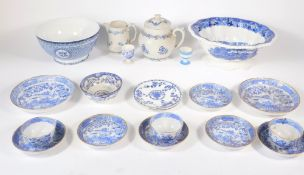 A group of blue and white ceramics.