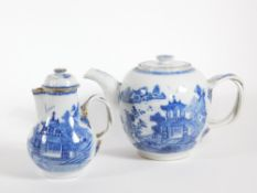 An early 19thC blue and white teapot, with double loop handle, basket moulded cover and neck, pagoda