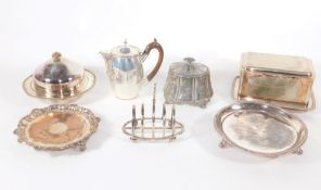 A silver plated muffin dish and cover, hot water jug, card tray, toast rack and other silver