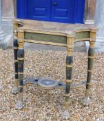 A Regency gilt and ebonised console or pier table in the manner of George Smith, the shaped top to