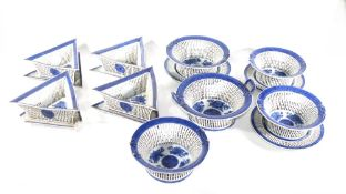 A 19thC Chinese porcelain suite of tablewares, including pierced baskets and stands. (AF - various
