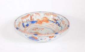 An 18thC Chinese porcelain bowl, with landscape and fisherman in central reserve in Imari colours,