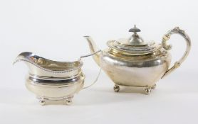 A late Victorian silver teapot, with swollen tapered body and flanged gadrooned border, leaf
