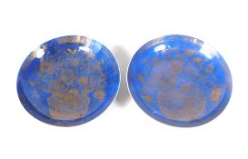 A pair of large Chinese powder blue ground saucer dishes, decorated with a gilt basket of flowers,
