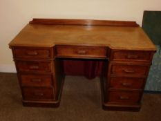 A Victorian mahogany pedestal desk, of inverted breakfront form, with a raised back, the top with