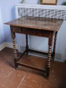 A late 17th/early 18thC oak side table, the rectangular plank top with a moulded edge, frieze drawer