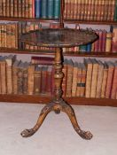 A mahogany occasional table, the circular dished pie crust top, on a turned column and tripod