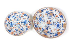 A 18thC Chinese platter, decorated in polychrome with a circular floral landscape, 32cm diameter,