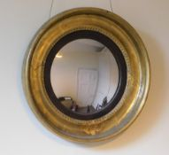 An early 19thC gilt Chester convex wall mirror, with an ebonised slip, later plate, the frame with