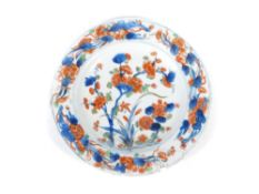 A Chinese 18thC plate, polychrome decorated with a floral landscape, 23cm diameter. (1)