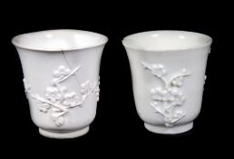 A pair of 19thC Chinese blanc de chine libation cups, 7.5cm high. (AF)
