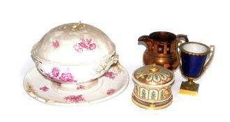 A pottery tureen, cover and stand, decorated with puce floral spray, together with a copper lustre