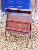 An Edwardian mahogany book and folio stand, with triangular end supports and slatted divisions on