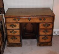 A George III mahogany kneehole desk, the top with a moulded edge above a frieze drawer and flanked
