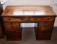 A 19thC mahogany kneehole desk or dressing table, the top with a moulded edge above an arrangement